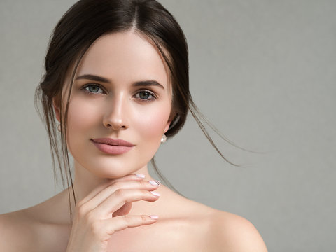 Beautiful woman face portrait healthy skin and beauty hairstyle happy smile