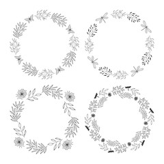 Set of elegant hand drawn floral wreaths. Circle wedding frames. Round vintage borders. Vector isolated illustration.