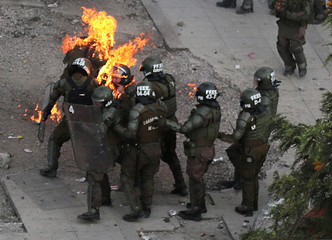 A Picture and its Story: Chilean police officers set on fire by Molotov cocktails
