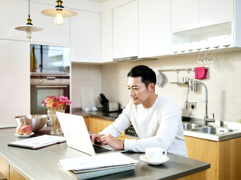 young asian man working from home