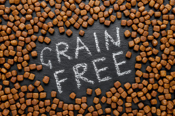grain free dog food on black background Wall mural