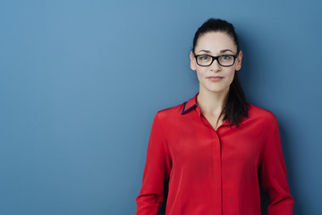 Serious young woman wearing glasses Wall mural
