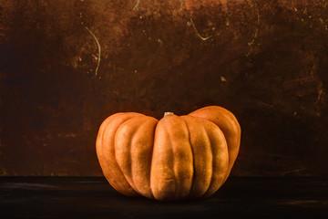 Orange pumpkin on dark background