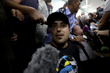 Jordanian citizen Abdul Rahman Miri speaks to the media upon his release by Israel, at the King Hussein Bridge crossing near Amman