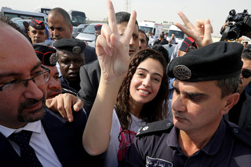 Jordanian citizen Hiba Labadi gestures upon her release by Israel, at the King Hussein Bridge crossing near Amman
