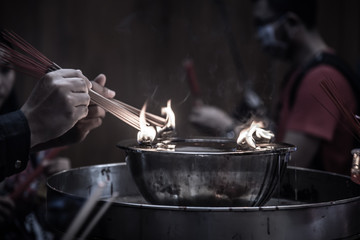 Incense burning at a temple in Wat Mangkon Kamalawat, Bangkok.