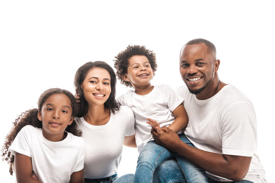 happy african american family smiling at camera isolated on white