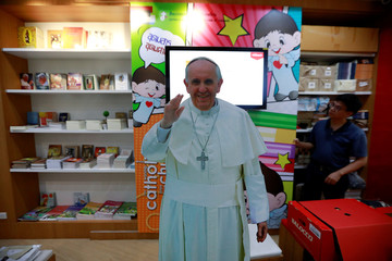A Pope Francis picture is seen in a souvenir shop in Bangkok