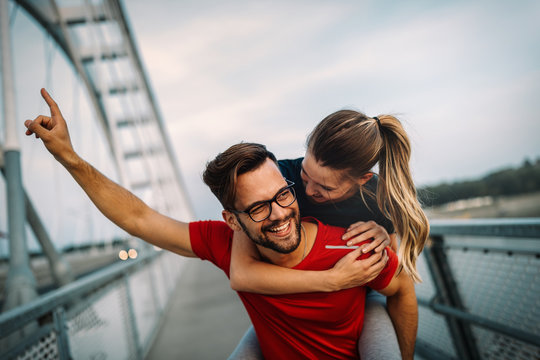 Fit happy couple having fun outdoor during exercise