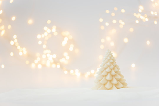 Christmas background with fir tree candle and defocused lights. Christmas or New Year celebration concept. Copy space