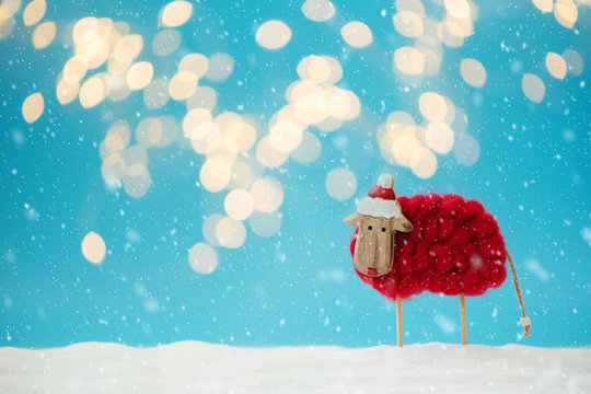 Snowy sheep (lamb) toy background. Christmas greeting card. Christmas or New Year celebration concept. Copy space