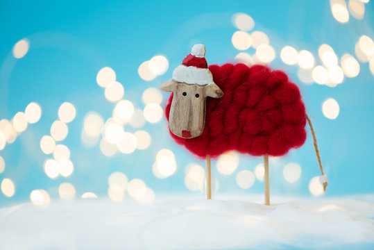 Sheep (lamb) toy background. Christmas greeting card. Christmas or New Year celebration concept. Copy space