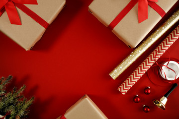Red flat lay background of christmas time. Free empty space for your product. Xmas gifts decoration...