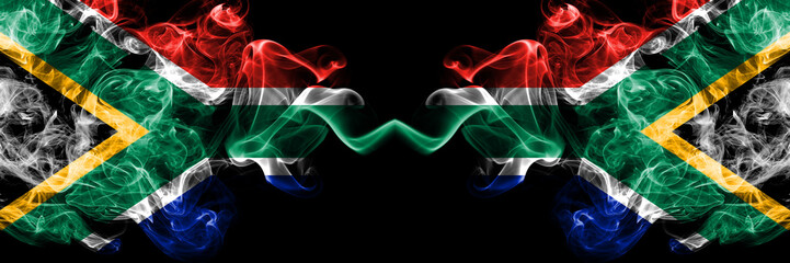 Foto op Canvas Afrika South Africa vs South Africa, African smoky mystic flags placed side by side. Thick colored silky abstract smoke flags concept