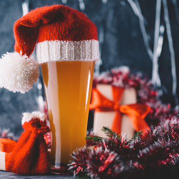 Christmas or new year beer in a hat in a festive atmosphere
