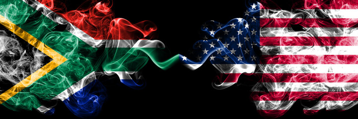 South Africa vs United States of America, American smoky mystic flags placed side by side. Thick colored silky abstract smoke flags concept