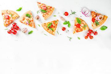 Pieces of cheese pizza Margarita with ingredients and herbs. White stone background top view