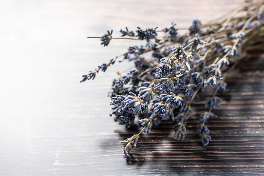 Bouquet of dry lavender on dark wooden table with copy space for your text.