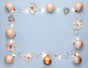 New year 2020. Merry Christmas and Happy Holidays greeting card. Christmas composition. Gold decorations on pastel blue background. Winter, new year concept. Flat lay, top view, copy space