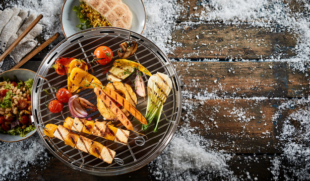 Assorted farm fresh vegetables grilling on a BBQ