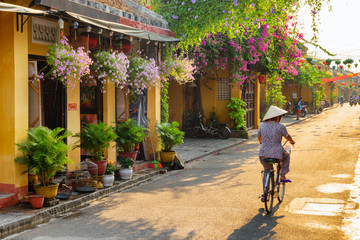 Fotobehang Fiets Amazing view of old street in Hoi An at sunrise