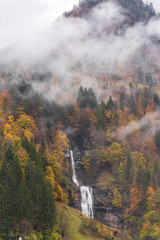 waterfall up in a misty mountain