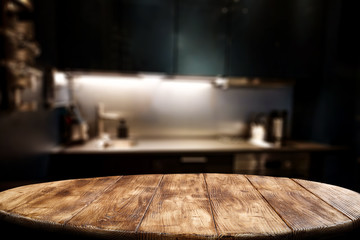 Wooden table background of free space for your decoration and blurred background of kitchen. Copy...