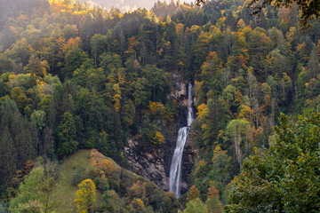 autumn in the mountains with waterfall
