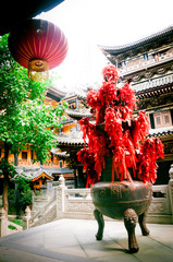 Token of prayers and giant red lantern in an ancient Buddhist temple -- Chongqing,China