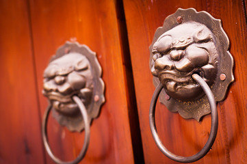 Traditional oriental door knock decorated in lion head style