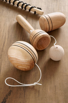 Vintage wooden toys including a yoyo spinning top and cup and ball