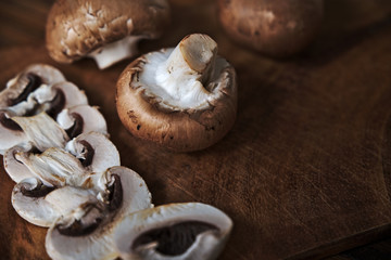 Close up of fresh mushrooms on wooden table