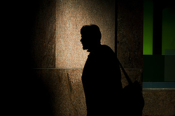 Silhouette of man near the building