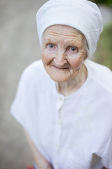 Portrait of smiling senior woman looking up