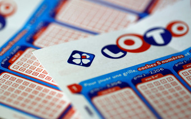 Logo and grids of French lottery group Francaise des Jeux are pictured in this illustration picture in Bordeaux