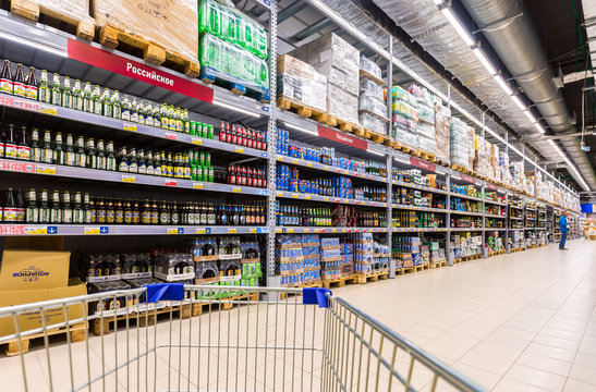 Alcoholic beverages. Shelfs of beverage, domestic and imported beer cans and bottles