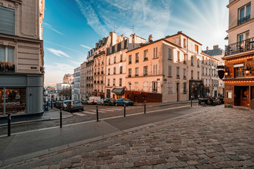 Streets of the Montmartre Quarter in Paris, France. Morning light with blue sky. Fototapete