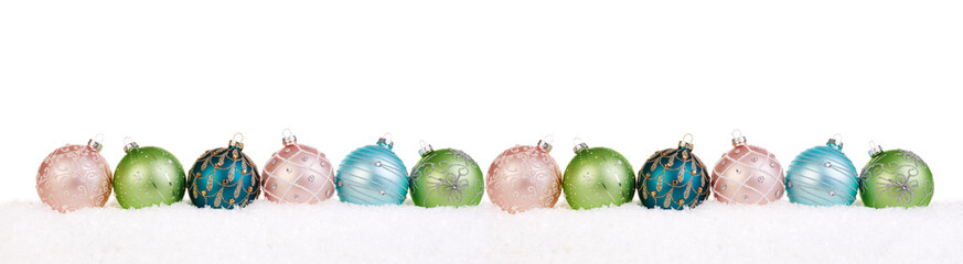 Colorful christmas balls in a row on snow, Christmas banner
