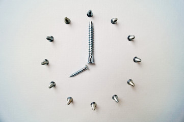 screws made of steel close up look like wall clock and euro union logo. time to work, eight in the morning
