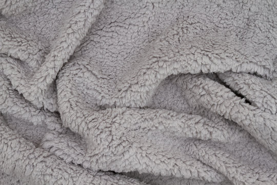 Gray sherpa textured plush fabric material background