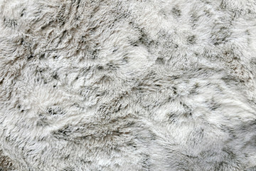 Soft and Cozy Faux Fur Textured White and Grey Blanket Background