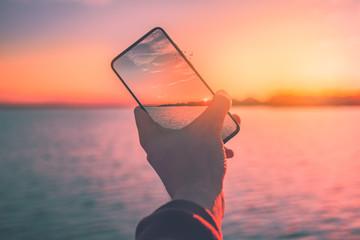 Zachód słońca z telefonem
