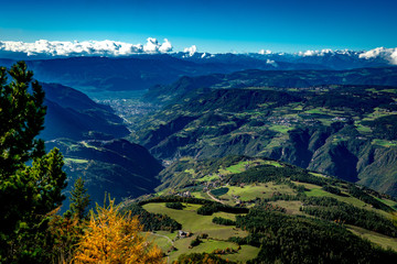 View from the Voelsegg mountain south overlooking Proesels and Oberaicha village to the  Eisacktal valley and the town Bozen on a bright autumn day with Unterinn and Oberbozen in the background