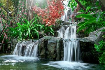 Obraz Artificial tropical garden waterfall - fototapety do salonu