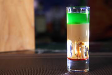 Hiroshima Cocktail. Shot Hiroshima at the bar. Alcoholic shot.