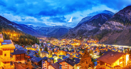 Wall Mural - Beautiful panoramic view of Zermatt, famous and popular resort in Switzerland. Iconic mountain Matterhorn on background. Twilight scenery. Traditional mountain Swiss cityscape. Banner of Zermatt.