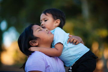 Siblings hug and embrace each other showing love, and affection, expressing that they will stand by each other.