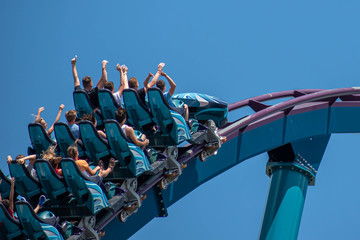 People enjoying riding amazing rollercoaster during summer vacation 4.