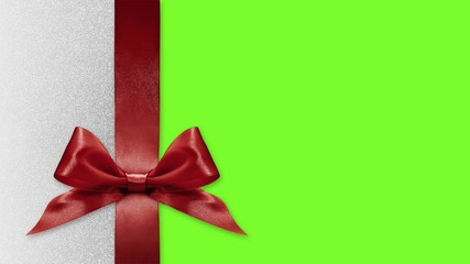 Fotomurales - merry christmas gift card, ribbon bows change colors isolated on green screen background template with copy space