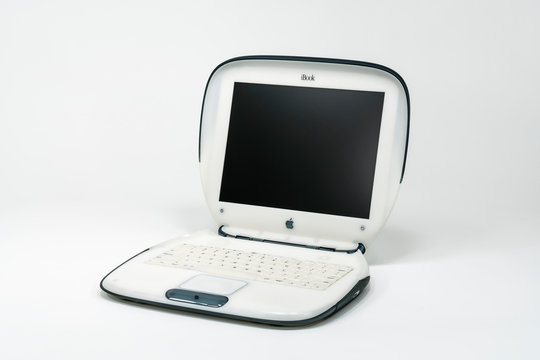 Illustrative editorial photo of old Apple clamshell style iBook laptop computer which was manufactured in the year 2000.  Photographed on November 6, 2019 in Los Angeles, California, USA.